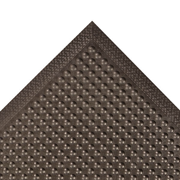 447 C BL Floormat.com Comfort-Eze™ is constructed with a unique solid rubber design that stimulates worker comfort and promotes product longevity. Offset bubbles on both the top and bottom of the mat provides flex and creates airflow resulting in maximum comfort for workers required to be on their feet for long periods of time. Competitive products feature only a flat or hollowed bottom which reduces the comfort of the mat. Although intended for use in dry environments, the top surface design is easy to wipe clean and the durable rubber compound is highly resistant to many cleaners and disinfectants so occasional spills can be cleaned up quickly and easily. Molded beveled edges on all four sides eliminates trip hazards by allowing for easy access onto and off the mat. <ul> <li>Long-lasting rubber compound</li> <li>Bubbles are molded on and offset on the top and bottom of the mat to maximize flex and create air flow, all to enhance the ergonomic benefit</li> <li>Durable rubber top surface easy to wipe clean using most cleaners and disinfectants</li> <li>All 4 sides feature a molded beveled border</li> </ul>