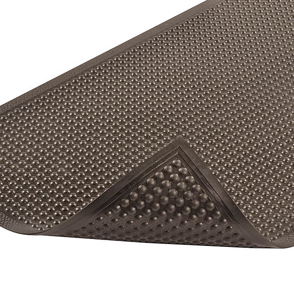 447 P2 BL Floormat.com Comfort-Eze™ is constructed with a unique solid rubber design that stimulates worker comfort and promotes product longevity. Offset bubbles on both the top and bottom of the mat provides flex and creates airflow resulting in maximum comfort for workers required to be on their feet for long periods of time. Competitive products feature only a flat or hollowed bottom which reduces the comfort of the mat. Although intended for use in dry environments, the top surface design is easy to wipe clean and the durable rubber compound is highly resistant to many cleaners and disinfectants so occasional spills can be cleaned up quickly and easily. Molded beveled edges on all four sides eliminates trip hazards by allowing for easy access onto and off the mat. <ul> <li>Long-lasting rubber compound</li> <li>Bubbles are molded on and offset on the top and bottom of the mat to maximize flex and create air flow, all to enhance the ergonomic benefit</li> <li>Durable rubber top surface easy to wipe clean using most cleaners and disinfectants</li> <li>All 4 sides feature a molded beveled border</li> </ul>