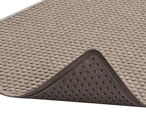 "Aqua Trap Antimicrobial 2 Floormat.com Aqua Trap® is a unique yet highly functional indoor entrance mat with a molded bubble pattern that facilitates the scraping and drying process while the patented raised ""Aqua Dam™"" border forms a perimeter that traps moisture and debris. Aqua Trap® features an antimicrobial carpet treatment that stops bacteria and germs at the entrance. An extremely durable rubber backed mat, Aqua Trap® has a highly fashionable look that features carpet-to-the-edge to blend with its surroundings and contemporary color choices to match any décor. <ul> <li>Moulded bubble pattern facilitates scraping and drying</li> <li>Aqua Dam™ border retains moisture and debris</li> <li>Carpet-to-the-edge construction to blend with its surroundings</li> <li>Rubber underside cleat design resists mat slippage</li> <li>Available in continuous lengths up to 60 feet</li> </ul>"