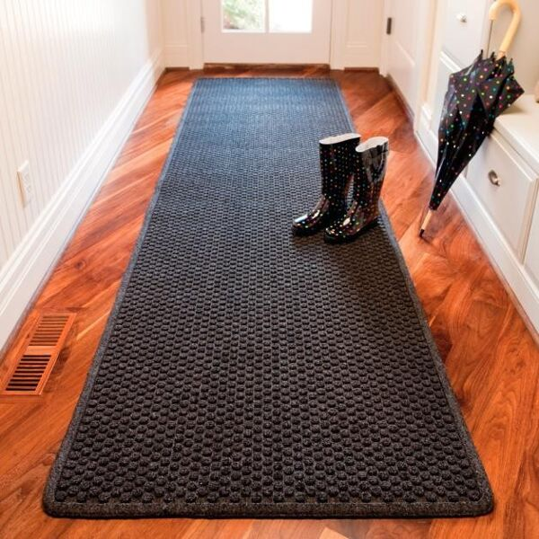 "Aqua Trap Entry Mat 1 Floormat.com Aqua Trap® is a unique yet highly functional indoor entrance mat with a molded bubble pattern that facilitates the scraping and drying process while the patented raised ""Aqua Dam™"" border forms a perimeter that traps moisture and debris. Aqua Trap® features an antimicrobial carpet treatment that stops bacteria and germs at the entrance. An extremely durable rubber backed mat, Aqua Trap® has a highly fashionable look that features carpet-to-the-edge to blend with its surroundings and contemporary color choices to match any décor. <ul> <li>Moulded bubble pattern facilitates scraping and drying</li> <li>Aqua Dam™ border retains moisture and debris</li> <li>Carpet-to-the-edge construction to blend with its surroundings</li> <li>Rubber underside cleat design resists mat slippage</li> <li>Available in continuous lengths up to 60 feet</li> </ul>"