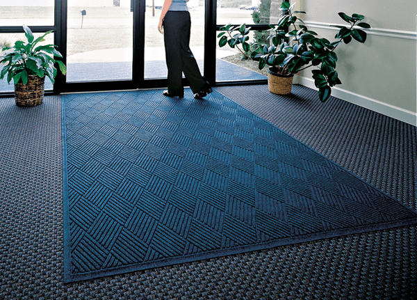 """Fashion Diamond Entrance Floor Mat Floormat.com Fashionable Wiper - Scraper Mat with Fabric Border. <ul> <li>24 oz.sq/yd Polypropylene fiber system dries quickly and won't fade or rot</li> <li>SBRrubber backing contains 20% recycled rubber content</li> <li>Unique """"Water Dam"""" and ridged construction effectively holds dirt & moisture between cleaning</li> </ul> <h2>Waterhog™ Fashion Diamond Mats</h2> Like Waterhog Classic Diamond, Waterhog Fashion Diamond mats offer the same performance features but with the added beauty of a fabric border for an attractive look that is easy to maintain. This tough as nails mat is the perfect choice for more decorative indoor areas where you want to put your best foot forward.<img class=""""alignright size-full wp-image-14972"""" src=""""https://www.floormat.com/wp-content/uploads/fashion-diamond-cross-section.gif"""" alt="""""""" width=""""300"""" height=""""114"""" /> <ul> <li>Unique ridged construction effectively traps dirt and moisture beneath shoe level.</li> <li>Exclusive rubber-reinforced face nubs prevent pile from crushing in high traffic areas, maintaining high performance and extending product life.</li> <li>Premium 24 ounce anti-static, 100% polypropylene fiber system dries quickly and won't fade or rot. When wet, the rubber-reinforced surface allows water to be wicked to the bottom of the mat, away from foot traffic and providing a slip resistant surface.</li> <li>Green friendly rubber backing has 10% - 15% recycled rubber content and is available in smooth or cleated backing types.</li> <li>Exclusive """"water dam"""" border keeps dirt and water in the mat and off the floor, minimizing slip hazards and floor damage.</li> <li>Highly durable attractive fashion border makes it the perfect choice for indoor or outdoor applications.</li> <li>Anti-static fiber system has a maximum average voltage of 1.6K as measured by the AATCC. Mats are safe for computer rooms and around electronic equipment.</li> <li>All Waterhog Mats are certified slip resistant by the Nati"""