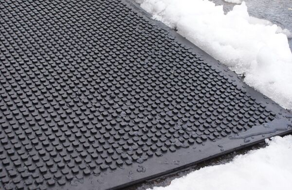 """HOT blocks door landing mat Floormat.com Avoid the hazardous fall on the ice this winter!The HOT-blocks™ outdoor industrial heated mats have been designed for keeping stairs, doorways, handicapped ramps, walkways and alleyways safe and ice free!<b> </b>They are safe and secure from accidents due to slipping and falling. They melt snow and ice on contact. The HOT-blocks™ outdoor heated mats are designed to withstand harsh winter conditions. <b>(GFCI Power Cord not included.)</b> <ul> <li>These mats are Eco friendly, inter-connectable, and versatile.</li> <li>100% Virgin Rubber</li> <li>Dimensions: 36"""" L x 24"""" W x 0.31"""" H</li> <li>Weight: 18 lbs</li> </ul>"""