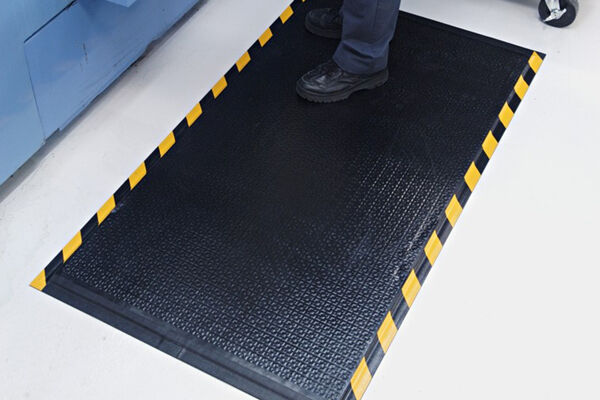 "Happy Feet Inuse Image Website 1 Floormat.com Happy Feet is a heavy-duty anti-fatigue mat that features a dense foam cushion encapsulated in nitrile rubber, making it suitable for both wet and dry environments. <ul> <li><b>Comfortable </b>- 1/2"" dense foam cushion and nitrile rubber surface provide excellent anti-fatigue qualities</li> <li><b>Safe</b> - Certified high-traction by the National Floor Safety Institute (NFSI)</li> <li><b>Durable</b> - Nitrile rubber surface is penetration proof; borders will not crack or curl</li> <li><b>Versatile</b> - Welding safe; grease/oil proof; chemical resistant; ESD rating of electrically conductive</li> <li>Available in two surface types: <strong><a href=""https://www.floormat.com/floor-mats/anti-fatigue-mats/happy-feet-textured/""><i>Textured Surface</i></a></strong> for dry/damp environments or <i>Grip Surface</i> for wet environments where additional traction is needed</li> <li>Available with solid black or with OSHA-approved yellow striped borders</li> </ul>"