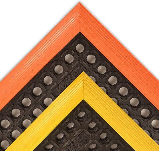 Safety Stance 1 Floormat.com Safety Stance® is made from a grease resistant rubber compound to withstand many of the more commonly found industrial cutting oils and chemicals. Particularly well suited for wet or dry work areas, Safety Stance® features a large hole drainage system with a mini-diamond studded top surface to minimize slippage. Beveled edges are made from a 100% Nitrile rubber compound offering the same resistance to oils/chemicals as the mat. <ul> <li>100% Nitrile rubber compound withstands many common industrial cutting fluids, oils and chemicals</li> <li>Large hole configuration facilitates drainage and resists clogging</li> <li>Raised studs on top surface add traction</li> <li>Colored beveled borders are permanently affixed to the mat and are available on 3 or 4 sides</li> </ul>