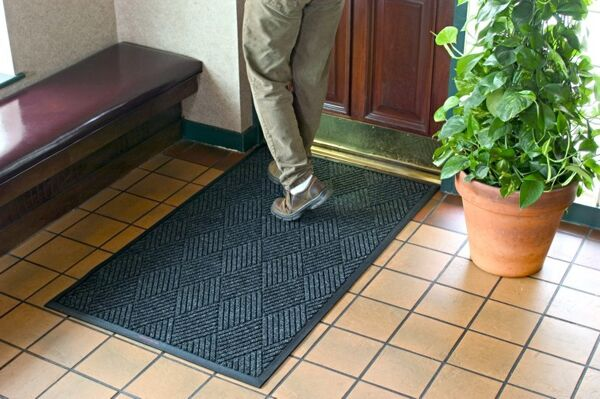 "Waterhog Classic Diamond 2 Floormat.com This indoor/outdoor entrance scraper mat is made of a 24 oz.sq/yd Polypropylene fiber system that dries quickly and won't fade or rot. <ul> <li>3/8"" thick bi-level surface effectively removes dirt and moisture beneath shoe level</li> <li>Rubber reinforced face nubs prevent pile from crushing extending performance life of product</li> <li>Unique ""Water Dam"" and ridged construction effectively holds dirt & moisture between cleaning</li> </ul>"