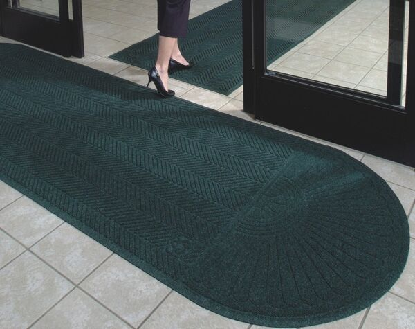 "Waterhog Eco Grand Elite 2 Floormat.com Entrance Scraper-Wiper Indoor or Outdoor Matting <ul> <li>Earth friendly 30 oz. sq/yd 100% post consumer recycled PET fabric from plastic bottles</li> <li>3/8"" thick bi-level surface effectively removes and stores dirt and moisture beneath shoe level</li> <li>Unique ""Water Dam"" allows the Waterhog mat to hold up to 1 1/2 gallons of water per sq yard</li> </ul> <h2>Eco-friendly & Luxury Carpet Matting</h2> Made of 100% Post-Consumer Recycled PET Polyester reclaimed from plastic drink bottles, this attractive new mat combines years of WaterHog bi-level cleaning technology with the most unique design concept ever! Who said a mat has to look like a ""door mat?"" Not anymore with these attractive diamond pattern mats! Great for Malls, Banks, Hotels Offices, Restaurants, Healthcare, Supermarkets, and more!<b>Andersen Waterhog Eco Grand Premier Benefits:</b> <ul> <li>Face fabric is heavy 30 oz./sq. yd. 100% Post-Consumer Recycled PET Polyester reclaimed from plastic drink bottles</li> <li>Eight Attractive Colors in Diamond Pattern</li> <li>New Fashion Borders</li> <li>Large Selection of Sizes</li> <li>Smooth or Special Tri-Grip Cleated Back to Minimize Movement; SBR Rubber with 15% post-consumer recycled tires</li> </ul> <img class=""size-full wp-image-14977 alignleft"" src=""https://www.floormat.com/wp-content/uploads/eco-roll-colors.jpg"" alt="""" width=""430"" height=""62"" /> <b>Eco Grand Premier Color Options</b>Color Key: Black Smoke, Grey Ash, Southern Pine, Indigo, Khaki, Chestnut Brown, Maroon, Regal Red"