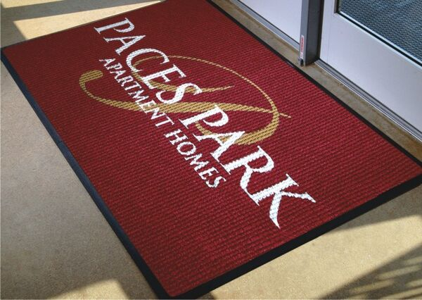"Waterhog Logo Inlay 1 Floormat.com Beautiful, long-lasting & practical image mats for any workplace! <ul> <li>3/8"" thick, 100% UV resistant polypropylene fabric for indoor and outdoor placements</li> <li>Molded rubber backing resists curling and cracking in all types of weather</li> <li>Perfect for high traffic areas</li> <li>Durable, UV resistant.</li> <li>Easy to clean! Vacuum, hose off or steam clean.</li> </ul> <h2>Waterhog™ Logo Inlay Mat</h2> With our unique inlay process, the logo or message is specially cut out of different carpet colors. These carpet sections are then pieced together and bonded to a rubber backing to create a beautiful, long-lasting and practical image mat for any workplace. Excellent durability and traction properties provide a slip-resistant surface which effectively removes tough dirt, grime and water from feet. Available in smooth and cleated backing types. All WATERHOG™ Logo Inlay mats are certified slip resistant by the National Floor Safety Institute. <ul> <li style=""list-style-type: none;""> <ul> <li>3/8"" thick, 100% UV resistant polypropylene fabric for indoor and outdoor placements</li> <li>Molded rubber backing resists curling and cracking in all types of weather.</li> </ul> </li> </ul> Available in smooth and cleated backing types. <ul> <li style=""list-style-type: none;""> <ul> <li>Earth-friendly rubber backing has 20% post-consumer recycled content</li> <li>Designs are created using a unique inlay process that can include up to 19 colors per</li> </ul> </li> </ul> mat at no additional charge. Search over a million designs in our logo database at www.andersenco.com <ul> <li>Available with your choice of Classic Rubber border or Fashion Fabric border</li> <li>No set up charge! Fast Service!</li> <li>Perfect for high traffic areas</li> </ul> <b>Andersen Logo Inlay Mat: Color Options</b><img class=""alignright size-full wp-image-14983"" src=""https://www.floormat.com/wp-content/uploads/waterhog-color-full-2.jpg"" alt="""" width=""1380"" height=""232"" />"