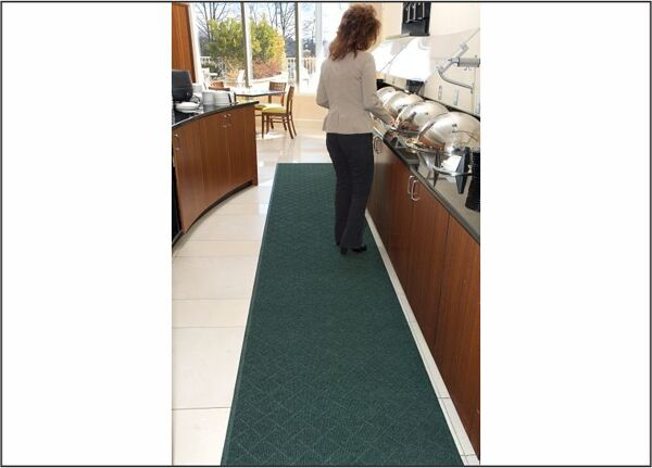 "buffet line Floormat.com Recycled PET carpet face and recycled tire rubber back make this wiper mat an excellent ""Green"" choice <ul> <li>Anti-Static, smooth backing only</li> <li>0 oz. sq/yd 100% post consumer recycled PET fabric from plastic bottles</li> <li>Recycled content is 89% of total product weight</li> </ul> <h2>Enviro PLUS features a recycled PET carpet face and recycled tire rubber back make this wiper mat an excellent ""Green"" choice</h2> <ul> <li>Wipes off moisture and finer dirt particles while providing protection to floor surfaces</li> <li>Perfect for use as a Wiper Mat in a 3-mat entrance system (1 - Outdoor-Scraper, 2 - Indoor-Scraper/Wiper, 3 - Indoor Wiper Mat)</li> <li>Use as a spill control and floor protection mat at water fountains, break areas, food counters, hallways and other interior applications</li> <li>Carpet face is UV resistant</li> <li>Anti-static</li> <li>Attractive Diamondweave pattern</li> </ul> <b>SPECIFICATIONS</b> <ul> <li>Face Fabric: 30 oz/sq yd 100% post-consumer recycled PET reclaimed from plastic drink bottles</li> <li>Face Construction: Non-woven needle punched</li> <li>Face Pattern: Diamondweave</li> <li>Backing: Flat Back Only. SBR (post-consumer recycled tires) and EPDM (post-industrial waste rubber)</li> <li>Thickness: 1/4""</li> <li>Total Weight: 100 ozs/sq yd</li> <li>Recycled Content: 89% of total product weight (76% post-consumer, 13% post-industrial)</li> <li>Flammability: Passes Federal Flammability Standard DOC FFI-70</li> <li>SPECIAL SIZES May be ordered in lengths up to 60'. Special size mats are available in whole foot increments only.</li> <li>SPECIAL SIZES Prices are per linear foot ($) 3' (35"") widths = $17.37 4' (45"") widths = $23.10 6' (70"") widths = $39.86</li> </ul>"