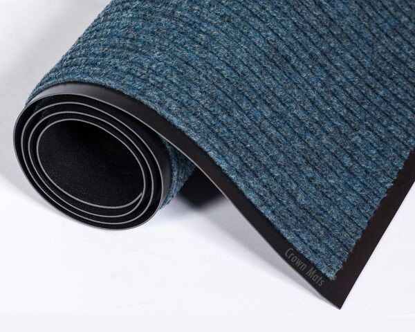 """c needle rib 1 Floormat.com Wiper/scraper ribbed-pattern mats for light traffic <ul> <li>Unilateral ribbed pattern on vinyl backing that traps moisture and protects floors</li> <li>Quick drying and fade resistant</li> <li>Retains moisture for increased cleaning efficiency</li> <li>For interior areas with light traffic e.g. Small business, Boutique and Side entrance</li> </ul> <h2>Needle-Rib™ Indoor Entrance Mats</h2> These economical, ribbed-pattern wiper/scraper carpet mats are recommended for interior entrances with light traffic of less than 125 people per day, such as small businesses, boutiques, and side entrances.<strong>Benefits:</strong> <ul> <li>Rugged grooves work vigorously to remove dirt and moisture</li> <li>Wear-resistant and colorfast to stay looking new longer</li> <li>Six brilliant colors to choose from</li> <li>Thickness: 5/16""""</li> <li>Backing: vinyl</li> <li>Top fibers: polypropylene</li> </ul>"""