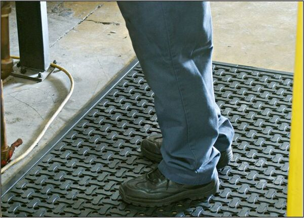"cf industrial Floormat.com Anti-fatigue, slip resistant mats for dry or wet environments indoors or outdoors, with or without grit<strong>Anti-fatigue, slip resistant mats for kitchens and industrial applications</strong>These durable mats come in a standard nitrile rubber version, or with an aggressive, silicon carbide anti-slip top surface. The mats feature: <ul> <li>High Density Closed Cell Nitrile Rubber Cushion has 15% recycled content</li> <li>Grease and oil proof, chemical resistant</li> <li>Static Dissipative and certified slip resistant by National</li> <li>Floor Safety Institute</li> <li>Welding Safe</li> <li>Beveled edges for safe transition from mat to floor</li> <li>Lifetime anti-microbial treatment to prevent odors and degradation of the mat</li> <li>Comfort Flow has drainage holes to allow liquids to flow through. Comfort Scrape has non-draining surface</li> <li>Light weight and flexible for easy handling and cleaning</li> <li>Recommended for kitchens and industrial applications</li> </ul> <img class=""alignleft wp-image-15053 size-medium"" src=""https://www.floormat.com/wp-content/uploads/comfort-flow-surface-300x231.jpg"" width=""300"" height=""231"" />"