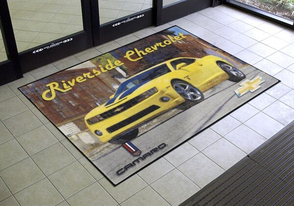 classic imp HD 1 Floormat.com Logos are printed onto carpet face; fine details, shading and 3-D images are achievable utilizing a state-of-the-art digital printer. <ul> <li>150 standard color options available. PMS color matching is available with an upcharge</li> <li>Available with cleated backing for placement on carpet or smooth backing for hard floor surfaces</li> <li>Heavy 32 oz/sq yd high twist, heat-set nylon face fabric</li> </ul>