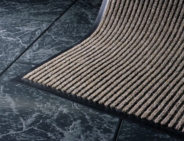 cobblestone closeup 1 Floormat.com Sturdy ribbed design scrapes and traps soil within the recessed grooves. Durable polypropylene face is effective against dust and lighter weight soil. <ul> <li>Easily cleaned by vacuum, hose or pressure washer</li> <li>Recommended for commercial buildings, hotels, restaurants, healthcare facilities, office building and more</li> <li>Not launderable</li> <li>Durable polypropylene face is effective against dust and lighter weight soil</li> </ul>