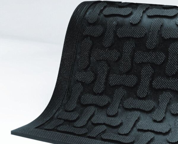 comfort scrape 1 Floormat.com Comfort Scrape has a non-draining surface, yet is light weight and flexible for easy handling and cleaning. This mat is welding safe as well as being static dissipative. It is grease and oil proof and chemical resistant. It is recommended for kitchen and industrial applications. <ul> <li>High density closed cell Nitrile rubber cushion has 15% recycled content</li> <li>Comfort Scrape with Grit, Product (#4300) has an added aggressive silicon carbide anti-slip top surface</li> <li>Beveled edges for safe transition from mat to floor</li> </ul>