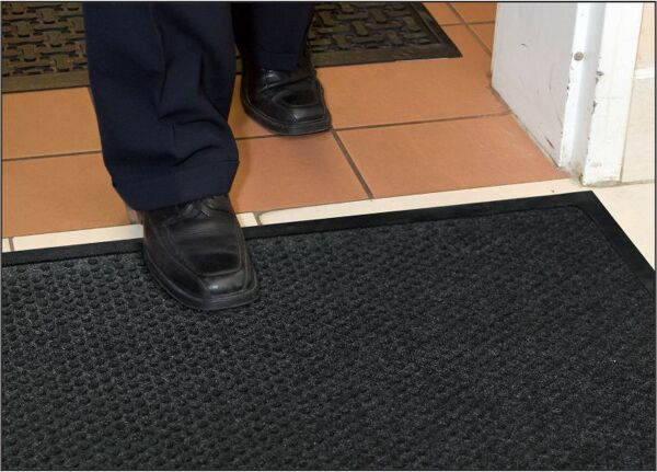 "grease hog 1 Floormat.com <h2>Indoor Scraper - Wiper Mats for kitchens and commercial applications</h2> <ul> <li>Solution-Dyed polypropylene fabric will not fade or rot</li> <li>Grease proof Nitrile rubber backing</li> <li>Permanently molded bi-level pattern on the carpet surface prevents pile from crushing and provides an anti-slip surface</li> <li>Low profile fabric construction ensures easy cleaning and quick drying</li> <li>Low profile reinforced borders ensure mat will lay flat and will not crack and break while allowing carts to cross easily</li> <li>Unique disk pattern on back of mat keeps it in place on hard floor surfaces. Available with cleated backing for carpeted surfaces.</li> <li>1/4"" thickness</li> <li>Perfect for use in kitchens to stop oil and grease from being tracked into the dining rooms causing stained floors and slip and fall hazards</li> </ul>"