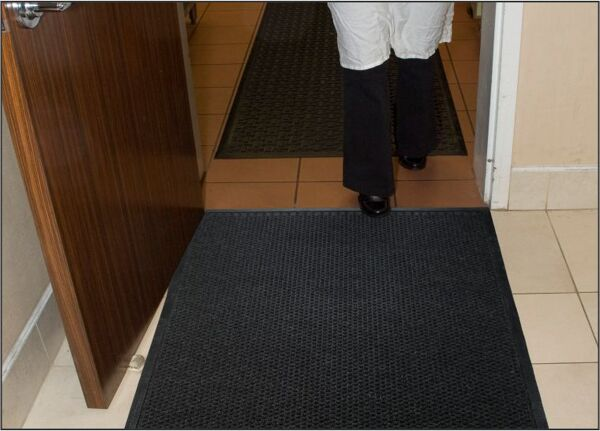 "grease hog 3 Floormat.com <h2>Indoor Scraper - Wiper Mats for kitchens and commercial applications</h2> <ul> <li>Solution-Dyed polypropylene fabric will not fade or rot</li> <li>Grease proof Nitrile rubber backing</li> <li>Permanently molded bi-level pattern on the carpet surface prevents pile from crushing and provides an anti-slip surface</li> <li>Low profile fabric construction ensures easy cleaning and quick drying</li> <li>Low profile reinforced borders ensure mat will lay flat and will not crack and break while allowing carts to cross easily</li> <li>Unique disk pattern on back of mat keeps it in place on hard floor surfaces. Available with cleated backing for carpeted surfaces.</li> <li>1/4"" thickness</li> <li>Perfect for use in kitchens to stop oil and grease from being tracked into the dining rooms causing stained floors and slip and fall hazards</li> </ul>"