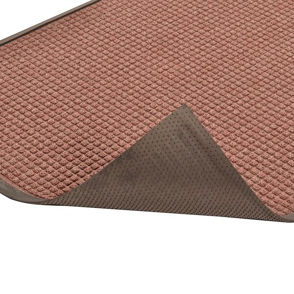 "guzzler 3 Floormat.com Guzzler™ is intended for use in medium to heavy traffic areas, the raised, crushproof waffle design of Guzzler™ aggressively scrapes and cleans, while the rubber-edged perimeter entraps dirt and moisture for superior water and soil control. Molded rubber ""cleats"" on the underside of the mat grip the underlying surface minimizing mat movement. <ul> <li>High/low waffle pattern facilitates scraping and keeps moisture and debris away from foot traffic</li> <li>Raised rubber border on all 4 sides traps moisture and debris for easy removal</li> <li>Molded rubber cleats on the bottom of the mat grip underlying surfaces and minimize mat movement</li> <li>26 ounces of tufted yarn per square yard</li> <li>3/8 inch overall thickness for use in narrow clearance doorways</li> </ul>"