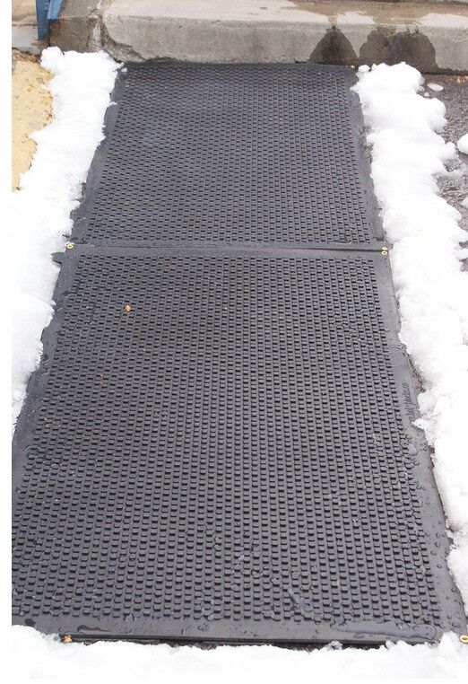 """hot blocks door landing mat 2 1 Floormat.com Avoid the hazardous fall on the ice this winter!The HOT-blocks™ outdoor industrial heated mats have been designed for keeping stairs, doorways, handicapped ramps, walkways and alleyways safe and ice free!<b> </b>They are safe and secure from accidents due to slipping and falling. They melt snow and ice on contact. The HOT-blocks™ outdoor heated mats are designed to withstand harsh winter conditions. <b>(GFCI Power Cord not included.)</b> <ul> <li>These mats are Eco friendly, inter-connectable, and versatile.</li> <li>100% Virgin Rubber</li> <li>Dimensions: 36"""" L x 24"""" W x 0.31"""" H</li> <li>Weight: 18 lbs</li> </ul>"""