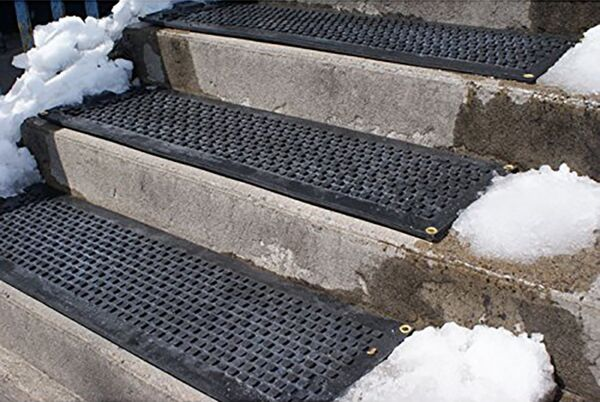 """hot blocks stair tread 01 Floormat.com Outdoor heated mats and heated stair treads melt snow & ice for safe footing without shoveling or chemicals. <b>(GFCI Power Cord not included.)</b> <ul> <li>GFCI Power Unit can connect up to 10 stair tread mats or 5 doormats or 4 walkway mats or any combination thereof, up to 15 amps.</li> <li>GFCI Power Unit Not Included</li> </ul> <h2>Residential Snow Melting Mats and Stair Treads for Safer Homes</h2> <strong>These heated mats prevent snow and ice accumulation on walkways and stairs around your home</strong>. Made of customized thermoplastic materials, the mats are portable and can be left outside for the entire winter season. Our heated mats will generate heat to melt snow at a rate of 2"""" per hour leaving your pathway to the home clean and clear 24/7. <strong>The Residential Heated Walkway Mat and Heated Stair Mat</strong> can be used independently or interconnected with one another to create a continuous system of snow melting mats. With the mats' built in watertight connector cables, you can Mix and Match walkway and stair mats to create your perfect snow melting solution - all on a single plug!<b>Heated Walkway Mats & Heated Stair Tread Mats</b> Payments are processed on a secure server. <h3>Customer Testimonials</h3> <div>""""We love our heated stair mats. They are working great during this cold Michigan winter."""" - Craig, Lansing, MI""""This is the best purchase I have made on a New product in ages! It performs better than I could believe! The safety advantage is outstanding. We get a lot of snow and this product kept up with Mother Nature wonderfully. I would give it 5 stars out of 5!"""" - Lexy, Alpine, NJ""""Purchased two about a month ago for my uncovered porch and deck. First tested by putting on deck with several inches of snow; the area was DRY in the morning! Have kept mat on front porch and it has handled more than the 2 inches of snow per hour stated! And we have had plenty--16 inches in one week!"""" - Gwen, Batavia, IL""""I li"""