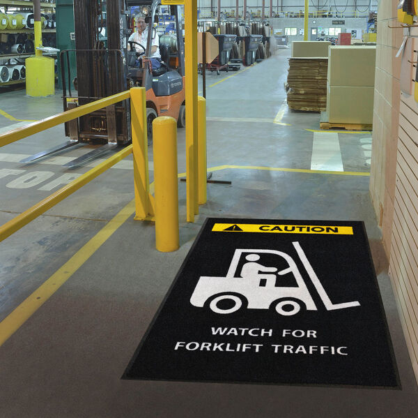 messageMat forklift Floormat.com Safety Message mats make your safety message loud and clear while keeping facilities cleaner and safer. Pre-printed message mats warn employees who may be entering a hazardous area, may need special ear or eye protection, or just act as a reminder to think and act safely in work environments. Pre-printed message mats offer functionality as an entrance mat cleaning dirt and moisture from shoes, keeping facilities cleaner and safer. Select messages are also available in Spanish. <ul> <li>14 pre-printed messages to choose from</li> <li>Highly visible colors and graphics for immediate identification</li> <li>24 ounce nylon top surface provides excellent moisture absorption and retention</li> <li>Heavy duty vinyl backing reduces mat movement</li> <li>Select messages also available in Spanish</li> </ul>