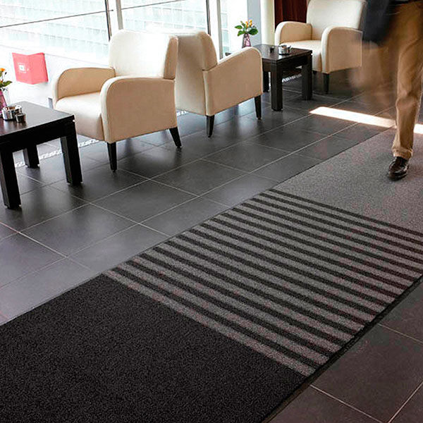 opera Floormat.com Opera™ combines 3 functional mats into 1 mat design. Zone 1 - A looped non-absorbent yarn to scrape debris and moisture from foot traffic. Zone 2 - Combines looped scraper yarns with absorbent Decalon™ looped pile to begin the drying process. Zone 3 - Pure Decalon™ looped pile to complete the drying function. All yarns are color-coordinated to combine beauty and functionality and is prefectly suited for all large upscale entrances including offices, hotels and professional office buildings. <ul> <li>All yarns are color-coordinated to combine beauty with functionality</li> <li>Dense combination of scraping and absorbent yarns ensure maximum performance</li> <li>3/8 inch overall thickness for use in narrow clearance doorways</li> <li>Vinyl backing helps reduce mat movement</li> </ul>