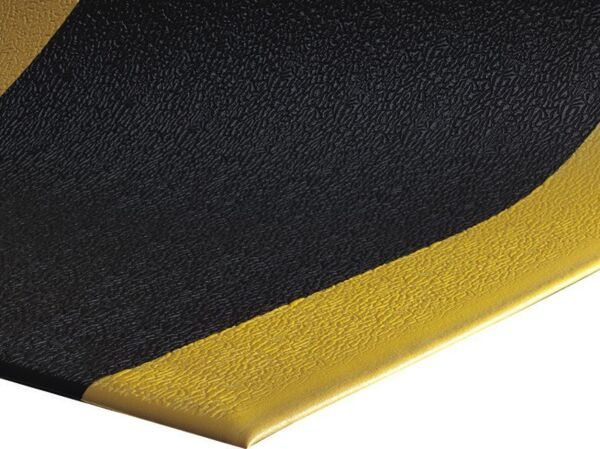 "scyellowborder Floormat.com <div id=""content_description"" class=""ty-wysiwyg-content content-description""> <div>Sure Cushion floor mats insulate against the cold and reduces noise levels. This 2 foot x 3 foot anti fatigue mat is constructed of ribbed, 3/8 inch PVC foam which is resistant to most chemicals and easy to clean. Sure Cushion floor mats provides floor protection and fatigue safety at an affordable cost.This cushion mat is black with a yellow border on both sides.</div> </div>"