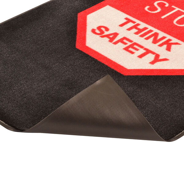 stop 1 Floormat.com Safety Message mats make your safety message loud and clear while keeping facilities cleaner and safer. Pre-printed message mats warn employees who may be entering a hazardous area, may need special ear or eye protection, or just act as a reminder to think and act safely in work environments. Pre-printed message mats offer functionality as an entrance mat cleaning dirt and moisture from shoes, keeping facilities cleaner and safer. Select messages are also available in Spanish. <ul> <li>14 pre-printed messages to choose from</li> <li>Highly visible colors and graphics for immediate identification</li> <li>24 ounce nylon top surface provides excellent moisture absorption and retention</li> <li>Heavy duty vinyl backing reduces mat movement</li> <li>Select messages also available in Spanish</li> </ul>