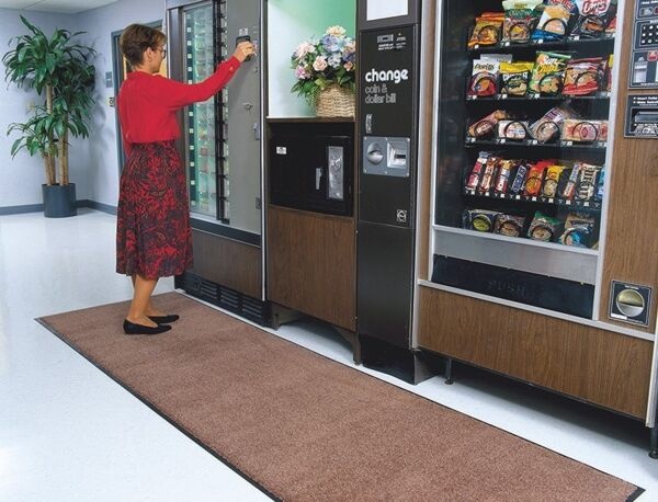 "stylist 1 Floormat.com <span data-offset-key=""epcq4-0-0"">Designed to release dirt easily with daily vacuuming or may be cleaned with any commercial carpet cleaning system. Recommended for commercial buildings, hotels, restaurants, healthcare facilities, office buildings, and more. Mat is not launderable.</span> <ul> <li>Edge maximizing the standing area</li> <li>The top will not separate</li> <li>Smooth non-skid vinyl backing</li> </ul>"