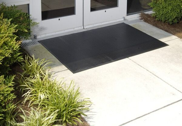 "super scrape 1 Floormat.com These 3/8"" mats are made of durable 100% Nitrile rubber that provide a slip-resistant surface and has 20% post consumer recycled content. <ul> <li>Molded tread-surface face cleats effectively scrape tough dirt and grime off shoes</li> <li>Effectively removes and stores dirt and sand beneath shoe level so it cannot enter the building</li> <li>Perfect for use outside of entrances as a scraper mat or as a slip resistant mat in wet areas</li> </ul>"
