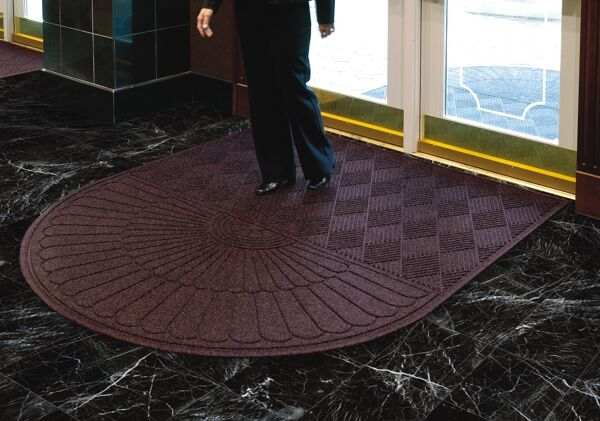 "waterhog eco grand premier 1 Floormat.com Entrance Scraper-Wiper Indoor or Outdoor Matting. The ends that are the rounded end of the mat. Some mats have two rounded ends. The application of the mat will determine which you need. If the mat will be directly against an entry door, you would only need one rounded end and the flat end will go against the door. <ul> <li>Stands up to salt and ice melt</li> <li>TriGrip rubber backing resists slipping, curling and cracking</li> <li>Passes Flammability Standard DOC-FF-1-70</li> </ul> <h2>Eco-friendly & Luxury Carpet Matting</h2> Made of 100% Post-Consumer Recycled PET Polyester reclaimed from plastic drink bottles, this attractive new mat combines years of WaterHog bi-level cleaning technology with the most unique design concept ever! Who said a mat has to look like a ""door mat?"" Not anymore with these attractive diamond pattern mats! Great for Malls, Banks, Hotels Offices, Restaurants, Healthcare, Supermarkets, and more!<b>Andersen Waterhog Eco Grand Premier Benefits:</b> <ul> <li>Face fabric is heavy 30 oz./sq. yd. 100% Post-Consumer Recycled PET Polyester reclaimed from plastic drink bottles</li> <li>Eight Attractive Colors in Diamond Pattern</li> <li>New Fashion Borders</li> <li>Large Selection of Sizes</li> <li>Smooth or Special Tri-Grip Cleated Back to Minimize Movement; SBR Rubber with 15% post-consumer recycled tires</li> </ul>"