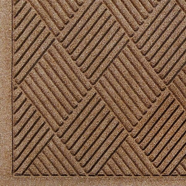 """waterhog fashion diamond 5 Floormat.com Fashionable Wiper - Scraper Mat with Fabric Border. <ul> <li>24 oz.sq/yd Polypropylene fiber system dries quickly and won't fade or rot</li> <li>SBRrubber backing contains 20% recycled rubber content</li> <li>Unique """"Water Dam"""" and ridged construction effectively holds dirt & moisture between cleaning</li> </ul> <h2>Waterhog™ Fashion Diamond Mats</h2> Like Waterhog Classic Diamond, Waterhog Fashion Diamond mats offer the same performance features but with the added beauty of a fabric border for an attractive look that is easy to maintain. This tough as nails mat is the perfect choice for more decorative indoor areas where you want to put your best foot forward.<img class=""""alignright size-full wp-image-14972"""" src=""""https://www.floormat.com/wp-content/uploads/fashion-diamond-cross-section.gif"""" alt="""""""" width=""""300"""" height=""""114"""" /> <ul> <li>Unique ridged construction effectively traps dirt and moisture beneath shoe level.</li> <li>Exclusive rubber-reinforced face nubs prevent pile from crushing in high traffic areas, maintaining high performance and extending product life.</li> <li>Premium 24 ounce anti-static, 100% polypropylene fiber system dries quickly and won't fade or rot. When wet, the rubber-reinforced surface allows water to be wicked to the bottom of the mat, away from foot traffic and providing a slip resistant surface.</li> <li>Green friendly rubber backing has 10% - 15% recycled rubber content and is available in smooth or cleated backing types.</li> <li>Exclusive """"water dam"""" border keeps dirt and water in the mat and off the floor, minimizing slip hazards and floor damage.</li> <li>Highly durable attractive fashion border makes it the perfect choice for indoor or outdoor applications.</li> <li>Anti-static fiber system has a maximum average voltage of 1.6K as measured by the AATCC. Mats are safe for computer rooms and around electronic equipment.</li> <li>All Waterhog Mats are certified slip resistant by the National Flo"""