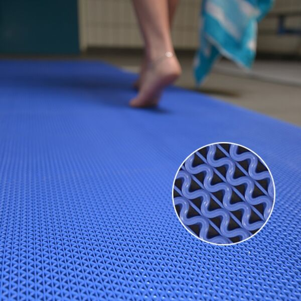 """z web 5 Floormat.com Provide slip-resistant footing in wet, barefoot traffic areas <ul> <li>Resistant to chemicals commonly found in locker rooms, around saunas, whirlpools, pools, and shower areas.</li> <li>The industrial grade PVC compound also provides greater resistance to caustic chemicals, oils, and greases.</li> <li>Resistant to fungus and mildew</li> <li>UV stable</li> <li>Built in fungicide to fight most common bacteria</li> <li>Free of: DOP, DMF, Silicone, Heavy metals, Ozone depleting substances</li> </ul> Web Trax Matting for wet areas is designed to help provide slip-resistant footing in barefoot traffic areas. All vinyl construction for durability and ease of care with a low profile.Web Trax Matting's resilient surface is comfortable for bare feet, providing slip resistant footing around locker rooms, saunas and showers. The vinyl is formulated for resistance to chlorinated water, body oils, fungus, soaps mildew and UV radiation. It also features a built in fungicide to fight the most common bacteria. The matting is also lightweight and easy to clean by either shaking dirt from the mat, or mopping it with a disinfectant cleaner and flushing with water. <h3>Open Z-web construction</h3> <ul> <li>Allows water to run through the matting</li> <li>Matting stays drier than surrounding area to help reduce the possibility of slips and falls</li> <li>Allows for quick, easy cleaning</li> <li>Lightweight</li> </ul> <em>Web Trax Colors</em></br> <img class=""""size-thumbnail wp-image-15084"""" src=""""https://www.floormat.com/wp-content/uploads/safety-walk-3200-colors-150x127.jpg"""" alt="""""""" width=""""150"""" height=""""127"""" /> <p> </p> <h3>Common applications</h3> <ul> <li>Locker rooms</li> <li>Around saunas</li> <li>Around whirlpools</li> <li>Around pools</li> <li>Shower areas</li> </ul> <h3>Special vinyl compound</h3> <ul> <li>Resistant to chemicals commonly found in locker rooms, around saunas, whirlpools, pools, and shower areas.</li> <li>Resistant to body oils</li> <li>Resistant t"""