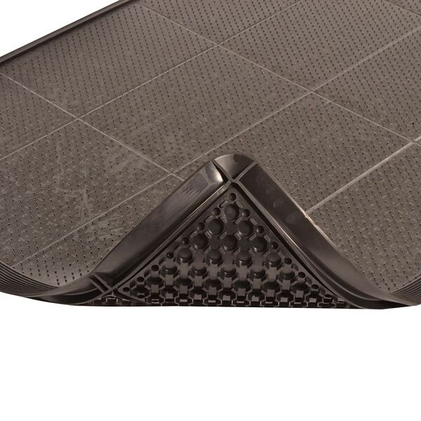 """580 P2 BL 1 Floormat.com Sorb Stance™ is the first modular anti-fatigue mat designed specifically for combined use with a sorbent pad in environments where pooling liquids can create a safety hazard. Made from a 100% Nitrile rubber compound, Sorb Stance™ is extremely resistant to chemicals, cutting fluids, oils and greases commonly found where sorbent pads are used. This unique mat offers anti-fatigue relief utilizing a raised footing system design on the underside of the mat that provides cushioning comfort and aeration. <ul> <li>100% Nitrile rubber compound for extreme resistance to chemicals, cutting fluids, oils, and greases</li> <li>Available in both stock sizes and on-site custom configurations</li> <li>A raised footing design on the underside of the mat provides cushioning comfort and aeration</li> <li>Molded beveled borders allow for easy access on to and off of the mat</li> <li>A recessed top surface acts as a tray that holds the sorbent pad and traps liquids</li> <li>The tray top surface has a series of molded pins that grip and hold the sorbent pad in place</li> <li>Designed to comfortably accommodate a standard 30"""" wide sorbent pad. (Inside tray width – 32"""")</li> </ul>"""