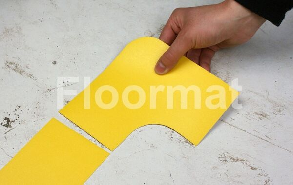 90 degree 100 1 Floormat.com Floormat.com warehouse markers are durable, self-adhesive signs constructed from industrial grade plastic. Intended for use in factory warehouses and buildings where restrictions and safety notifications need to be highlighted.