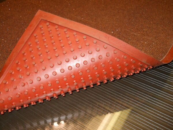 """ComfortSuperG Floormat.com Extremely slip-resistant floor mats for wet, oily and greasy floors, ramps, stairs, walk-in freezers and other slippery surfaces <ul> <li>Made with crushed garnet and ceramic beads for secure footing </li> <li>Backing restricts creeping</li> <li>Low profile eliminates tripping hazard and allows it to be placed under thresholds </li> <li>Resists fungal & bacterial growth </li> <li>The Grip Rock mats are 3/8"""" thick</li> <li>They are 3' wide and can be purchased per lineal ft as well (3' x 3' for example)</li> </ul> <h2>Grip Rock and Super G slip-resistant safety mats are:</h2> <ul> <li>Slip-resistant in water, grease, and oil</li> <li>Extremely tough and durable</li> <li>Flexible even in freezing temperatures</li> <li>Lightweight and thin (1/8 inch thick, a 3' x 10' is only 25 pounds)</li> <li>No installation needed</li> <li>Easy to handle, clean, and maintain</li> <li>The regular version has a tacky polyurethane backing that is especially conducive to temporary floor adhesion and slip resistance. It is meant to be removed and cleaned and moved around as necessary.</li> </ul> Order either online below. Standard width is 3 feet to a maximum length of 40 feet. <strong>Grip Rock slip-resistant floor mat</strong> has a unique surface, incorporating round textured ceramic beads and crushed garnet to minimize slipping while facilitating easy cleaning. Grip Rock safety mats are designed to be slip-resistant in wet, hazardous areas including walk-in freezers, wet and slippery ramps, and stairs indoors or outdoors. Grip Rock safety mat is constructed of rugged components: <ul> <li>Tacky and durable polyurethane backing to prevent hydroplaning - mat stays put</li> <li>A middle layer of fiberglass that prohibits tearing and increases strength</li> <li>A durable top layer of ceramic beads and crushed garnet in a polyurethane matrix</li> <li><strong>Super G</strong> has the same basic properties of Grip Rock but has a special abrasive top surface designe"""