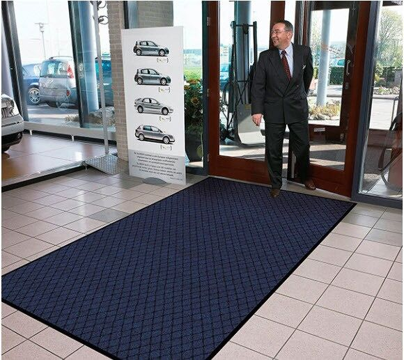 Evergreen Diamond 3 Floormat.com Evergreen Diamond™ features a fashionable diamond pattern design made from 100% recycled carpet fibers. A hefty 25 ounce per square yard tufted loop pile top surface allows the mat to capture debris and moisture while maintaining its attractive appearance. A heavyweight vinyl non-slip backing ensures minimum movement. <ul> <li>Carpet fibers made from 100% recycled material</li> <li>25 ounce tufted loop pile carpet for increased moisture retention</li> <li>3/8 inch overall thickness for use in narrow clearance doorways</li> <li>Vinyl backing helps reduce mat movement</li> </ul>