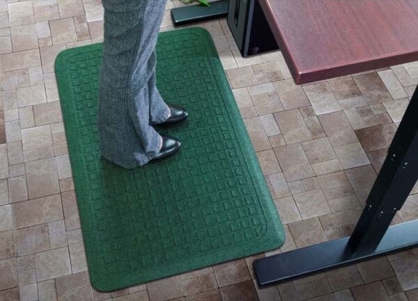 """Get Fit Stand Up 1 1 Floormat.com These Get Fit Stand Up Anti-fatigue Mats are ideal for standing desks and other standing work areas. The anti-fatigue indoor mats are designed to provide workers a comfortable surface to stand on for hours and hours. Standing at your desk can burn up to 40% more calories while reducing neck & back pain. Do it for your health Get Fit with these Stand Up Anti-fatigue Mats. <ul> <li>100% solution-dyed polypropylene top surface will not fade</li> <li>5/8"""" thick closed cell Nitrile blended cushion</li> <li>Beveled borders will not crack and curl</li> <li>Made in the USA</li> </ul>"""