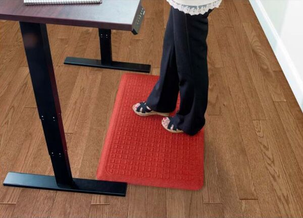 """Get Fit Stand Up 2 1 Floormat.com These Get Fit Stand Up Anti-fatigue Mats are ideal for standing desks and other standing work areas. The anti-fatigue indoor mats are designed to provide workers a comfortable surface to stand on for hours and hours. Standing at your desk can burn up to 40% more calories while reducing neck & back pain. Do it for your health Get Fit with these Stand Up Anti-fatigue Mats. <ul> <li>100% solution-dyed polypropylene top surface will not fade</li> <li>5/8"""" thick closed cell Nitrile blended cushion</li> <li>Beveled borders will not crack and curl</li> <li>Made in the USA</li> </ul>"""