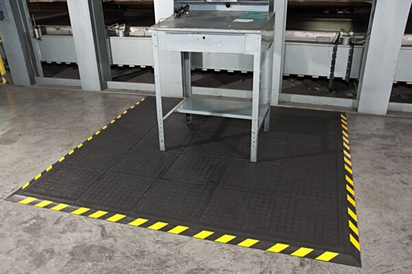 Hog Heaven II Modular 2 Floormat.com Recommended for distribution, manufacturing and retail facilities for picking lines, assembly lines, workstations, check-out stations and more. Nitrile rubber surface is molded to the cushion backing (not glued) so the surface does not delaminate. The mats cushion is a closed cell Nitrile rubber cushion that provides long-lasting comfort. <ul> <li>Rubber surface remains flexible for the life of the product and will not curl or crack</li> <li>Border is available in black and yellow striped</li> <li>Electrically conductive,and welding safe</li> </ul>