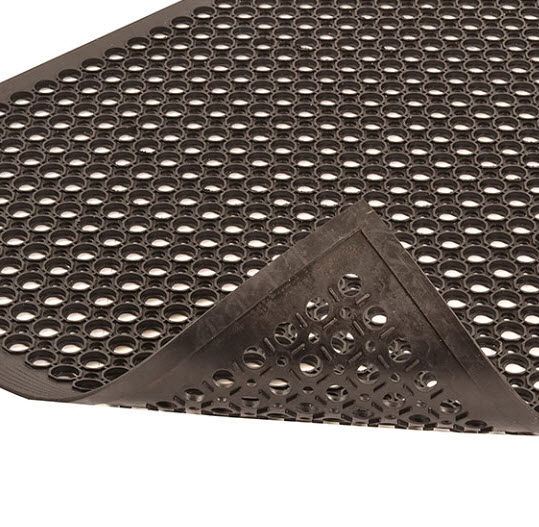 SaniTop 2 Floormat.com Sanitop® is made from a durable rubber compound designed to withstand harsh chemicals while creating a slip resistant surface. An alternating large and small hole drainage system channels liquid and debris away from the work area further enhancing the traction of the mat. Molded in beveled edges on all four sides eliminates trip hazards. Sanitop® offers a simple, economical solution for wet environments in many industrial or food service applications. <ul> <li>Durable rubber compound</li> <li>Molded alternating large/small hole drainage system keeps moisture and debris away from work area</li> <li>Raised pattern surrounds large holes to channel drainage and provide worker traction</li> <li>Molded beveled ramps on all 4 sides to minimize trip hazards</li> <li>Available in 2 versions:</li> <li>Black grease resistant mat - carries a 1-year warranty</li> <li>Red grease-proof mat with extra nitrile content - carries a 3-year warranty</li> </ul>
