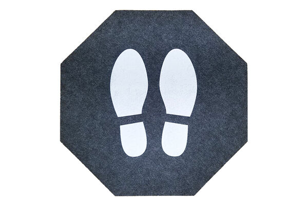 """Stick and Stand Isolated full mat 900x600 1 Floormat.com Stick-and-Stand mats are adhesive-backed social distancing mats designed to mark a safe place for customers to stand while waiting in lines. <strong>Sold by case only, with 6 mats per case.</strong> <ul> <li>Universal """"stop sign"""" shape with shoe prints marks where customers should stand; mats can be placed at safe intervals in virtually any configuration.</li> <li>Adhesive backing keeps the mat flat and in place, even with heavy cart and buggy traffic.</li> <li>Mats can be left in place during daily floor cleaning; floor scrubbers, mops, and brooms will pass right over them without causing damage.</li> <li>Less likely than floor decals to leave a sticky residue.</li> <li>Treated with an anti-microbial formula for protection from odors.</li> <li>Low-profile design with a high-traction surface to enhance slip resistance.</li> <li>Mat lifetime is up to 3 to 4 months under normal use.</li> </ul>"""