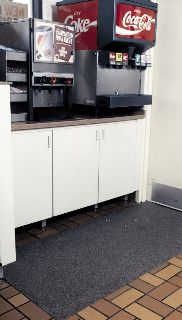 """brite tack 1 Floormat.com The Brite-Trac™ Matting is designed for areas your customers will see - buffet lines/ beverage stations. Features an aggressive abrasive surface for great traction. Brite-Trac™ products are all manufactured specifically for maximum slip resistance and safety. From the backing, which restricts creeping; to the inner fiberglass layer for strength; to the extreme textured surface. The low profile allows carts to travel easily over it and reduces a tripping hazard. Provide your employees/customers with protection from slips, trips and falls, which can be costly. <ul> <li>Thick- 1/8"""" Roll- 3' x 40'</li> <li>Slip resistant when wet/icy</li> <li>Stays flexible at freezer temperatures</li> <li>Tough, but lightweight</li> <li>Easy to clean & handle</li> <li>Reduces slips/falls</li> <li>Resists fungal & bacterial growth</li> </ul>"""