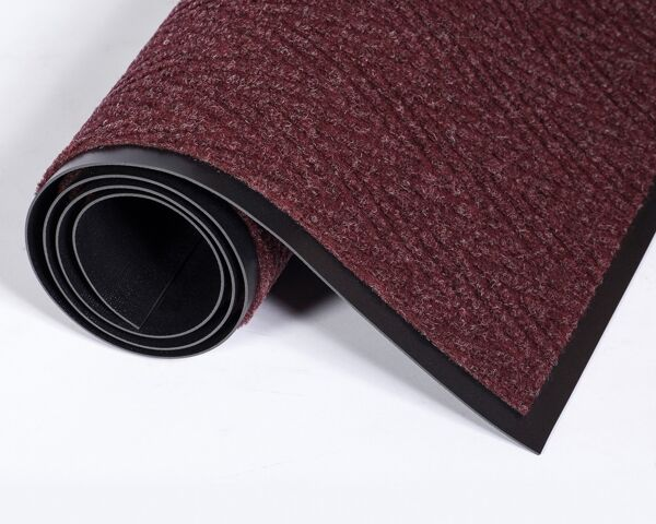 """chevron burgundy 3284 Floormat.com Wiper/scraper mat featuring chevron-patterned surface and standard vinyl backing for medium traffic <ul> <li>Crush resistant surface reduces appearance of foot traffic</li> <li>Raised berber-style surface that scrapes dirt and removes moisture efficiently</li> <li>Decorative needlepunch V-pattern is easy to clean and performs well in multi-directional traffic areas</li> <li>Please note: Rubber-soled shoes may act as insulators, causing the mat to function improperly.</li> </ul> <h2>Chevron Herringbone Floor Mats & Matting</h2> Vinyl-backed needle punch wiper/scraper mat featuring chevron-patterned surface and standard vinyl backing for medium traffic. We offer it in standard mat sizes, rolls, or can provide custom mats for your requirements. <h2>Custom Shapes</h2> <img class=""""size-medium wp-image-15002 alignleft"""" src=""""https://www.floormat.com/wp-content/uploads/chevron-notrax-custom-shape-300x236.jpg"""" alt="""""""" width=""""300"""" height=""""236"""" />Floormat.comcan provide it in a wide variety of custom sizes and shapes, with angle cuts for offset doorways, circular cuts to fit openings, and more. Heavy duty edging can be added for higher traffic areas. Simply <a title=""""Email template"""" href=""""mailto:info@floormat.com?subject=Chevron%20Custom%20Shape%20Template"""">e-mail a template</a> with dimensions for a quote.<strong>Benefits:</strong> <ul> <li>High quality carpeting sculptured in a distinctive herringbone pattern.</li> <li>Hi-lo carpeting of 100% polypropylene brushes dirt and moisture off shoes — for later """"shake out"""" cleaning or vacuuming.</li> <li>Wear-, fade- and crush-resistant</li> <li>Distinctive contemporary look</li> <li>Can be seamed to create large, custom sizes.</li> <li>Exceptionally durable. Ideal for indoor or outdoor use.</li> <li>Color-coordinated, heavy duty vinyl base is slip and stain resistant.</li> </ul>"""