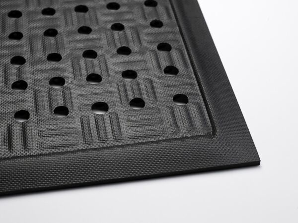 "cushionstation 1 Floormat.com Cushion Station mats are ideal for use in machine shops, work stations or other heavy industrial applications, medical facility environments, kitchens, showers, and locker rooms. Grease and oil proof and static dissipative. Welding safe with a thickness of 7/8"". <ul> <li>Highly durable closed-cell Nitrile rubber cushion combined with uniquely designed construction affords excellent anti-fatigue properties</li> <li>Available with or without holes</li> <li>Flexible Nitrile cushion construction can be cleaned easily. May also autoclave to sterilized.</li> </ul>"