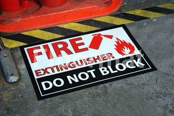 fm06 fire extinguisher do not block sign Floormat.com Floormat.com warehouse signs are durable, self-adhesive signs constructed from industrial grade plastic. Intended for use in factory warehouses and buildings where restrictions and safety notifications need to be highlighted.
