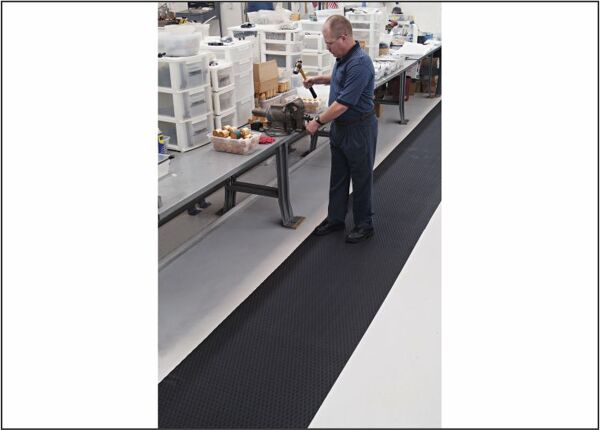 """full shot Floormat.com Ideal for numerous production locations, walkways, gym floor protection, parts counters, lab areas and food service applications. <ul> <li>Slip resistant floor protection matting made from chemical-resistant Nitrile rubber foam</li> <li>1/4"""" thick and contains 15% post-consumer recycled rubber content</li> <li>UV protected, grease/oil proof, welding safe and static dissipative</li> </ul>"""
