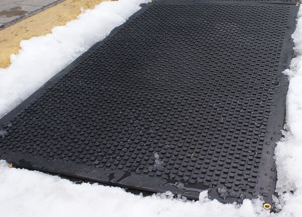 hot blocks stair treads 02 Floormat.com Dry, safer footing at your entrances. <b>(GFCI Power Cord not included.)</b> <ul> <li>UV Protected anti-slip heated rubber mats are built tough and solid enough to be used on driveways, and high traffic areas.</li> <li>All HOT-blocks mats have waterproof, inter-connectable screw type connectors, to prevent water infiltration.</li> <li>GFCI Power Cord not included.</li> </ul> <h2>Heated Carpet Mats Melt Snow & Ice w/o Shoveling or Chemicals</h2>   Our industrial-quality, snow melting entrance mat is an electrically heated carpet mat designed to prevent snow and ice accumulation around your facility's entryway. The mat is constructed with heavy duty weatherproof olefin fiber so it can endure the harshest of winter elements while providing your facility with the look of a sleek, carpeted entrance mat. The Entrance Mat plugs into any standard 120V outlet generating heat to melt snow at a rate of 2 inches per hour. The ribbed carpet surface captures salt and dirt from the bottoms of shoes, so you can prevent dangerous slip and fall accidents outside your facility, while keeping the mess from being tracked inside. Turn the mat on before or after a snow fall and watch the mat melt snow on contact--no more shoveling, salting, or slipping! Logo printing is available (please call us). Choose from three sizes to meet the needs of most commercial entrances – 24 in. x 36 in., 30 in. x 48 in. or 40 in. x 60 in. <b>HeatTrak Snow Melting Carpet Mat Specifications</b>: <ul> <li>Color: Black</li> <li>Surface Material: High UV Olefin Fiber</li> <li>Cord Length: 6 Foot</li> <li>Warranty: 2 Years</li> <li>Total Thickness: 0.5 inches</li> </ul> <b>Snow Melting Carpet Mats</b>