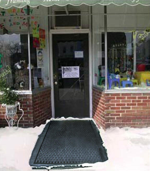 """ice away heated mats 2 Floormat.com The <strong>Ice-Away™</strong> <strong>snow & ice melting mat</strong> combines a rugged, non-slip outdoor mat with a snow-melting system that keeps entrances safe from the harsh winter environments. <ul> <li>Product Dimensions: 35"""" L x 33"""" W x 0.5"""" thick</li> <li>Keep up with snow as fast as it falls and forget about constant shoveling and salting sidewalks.</li> <li>Prevent dangerous & icy conditions. Avoid slip-and-fall injuries</li> <li>240 watts</li> <li>Entrances,Ramps, Loading docks, Hospitals, Nursing Homes, Handicap-accessible structures, Hotels, Schools, Churches, Private homes</li> <li>Weight: 17lbs, Power Density: 40 Watts per square foot, In-Line Safety Device/Power Cord Service Voltage 120 Vac ELCI trip level 27 mA</li> <li>Cord lead length (nominal) 15 ft.</li> </ul> <h2>Heated Doormats Eliminate Shoveling or Chemicals</h2> The new Greener Heat™ Heated Door Mat melts snow and ice at your door, on porches, decks, and around hot tubs. Measuring 36W x 33L inches, the heated doormat produces a 40 to 50 degree Fahrenheit rise in surface temperature over the ambient temperature, melting snow and ice 24/7.<strong>Features & Benefits</strong> <ul> <li>Economical, using only 35 watts per square foot.</li> <li>The molded rubber mat features heavy-duty construction that is made to last for years. Weighing over 14 lbs, most winds will not move it.</li> <li>Measuring 36 inches wide x 33 inches long, the Greener Heat doormat will help prevent thick ice build up when properly used. Designed to stay on all winter, the mat may also be used without power in warmer periods, making a very nice entrance mat all year round.</li> <li>G.F.C.I. attached to the 15 foot cord. The mat is E.T.L. approved.</li> <li>These heated entrance mats are an ideal size for residential use – use outdoors to melt snow and ice, or indoors as a heat source in non heated areas.</li> </ul> <b>Outdoor Uses</b> <ul> <li>Door Front</li> <li>Porch</li> <li>Around H"""