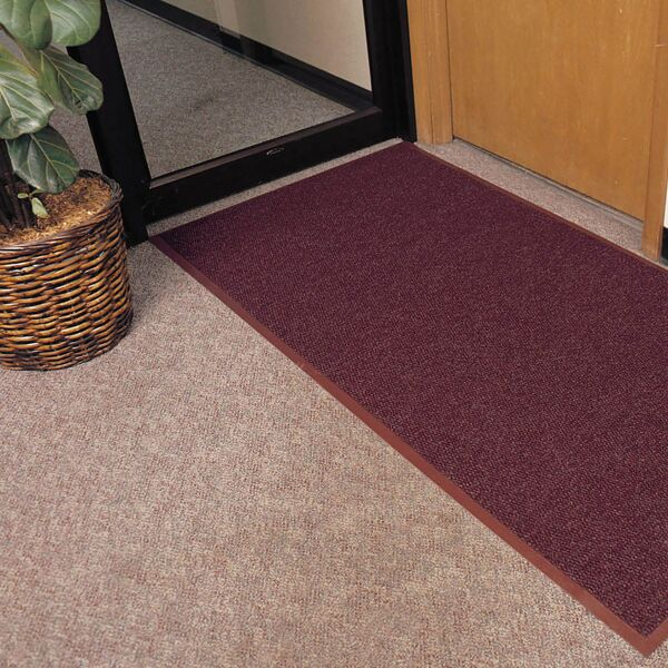 """polynib 2 1 Floormat.com Polynib® has the rich, luxurious look of Berber-style carpeting for an always elegant appearance. A very tightly nibbed loop of needle-punched yarn entraps and hides debris while retaining moisture at the same time. 24 ounces of carpet per square yard provides greater crush resistance for long lasting wear. Polynib® comes with a heavy-weight vinyl backing in corresponding colors to help reduce mat movement and enhance the aesthetic appeal of the mat. <ul> <li>Tightly nibbed loop construction entraps debris and hides it for an always elegant appearance</li> <li>24 ounces of needle-punched yarn per square yard</li> <li>1/4 inch overall thickness for use in narrow clearance doorways</li> <li>Vinyl backing in corresponding colors helps reduce mat movement</li> <li>Recommended product as a part of the GreenTRAX™ program for """"Green Cleaning"""" environments</li> <li>Custom lengths available (3', 4', and 6' widths)</li> <li>Available Colors: Charcoal, Slate Blue, Brown, Hunter Green, Gray</li> </ul>"""
