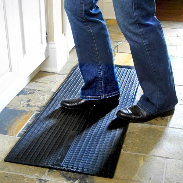 "super foot warmer Floormat.com Safe and economical – using one tenth the energy of dangerous space heaters. <ul> <li>Uses only 135 watts; 90% less than a standard 1,500 watt space heater</li> <li>TUV Listed - meets strict safety standards</li> <li>Warms cold feet directly through shoes or boots</li> <li>Perfect for under desks & standing work stations</li> <li>May be used to melt snow from boots, leaving them warm & dry</li> </ul> <h2>Heated Anti-fatigue Desk Mats Provide Warmth, Increase Productivity</h2>  <strong>Heated, under desk floor mats provide warmth and anti-fatigue comfort in cold climates and winter months.</strong><strong>The warmed mat is both safer and more economical than a space heater.</strong><strong>Features & Benefits</strong> <ul> <li>Winter Warmth Mat generates a radiant heat which creates an extremely comfortable even heat while reducing fatigue and stimulating circulation.</li> <li>Increased economy and safety!</li> <li><b>Timer accessory assures that never again will an owner or manager need to return to the office<img class=""size-thumbnail wp-image-14952 alignright"" src=""https://www.floormat.com/wp-content/uploads/winter-warmth-mat-use-150x150.jpg"" alt="""" width=""150"" height=""150"" /> to make sure space heaters are turned off</b>. It also provides on-off function so the mat does not have to be plugged/unplugged to control function.</li> <li>Even should the Winter Warmth Mat be left on, it assures safety and lower energy costs than space heaters.</li> <li>Ideal for people who spend long hours on their feet or in cold environments, including bank tellers, toll booth operators, machinists and any other users of space heaters.</li> <li>Designed for use on hard floors only (do not use on carpet).</li> </ul> <img class=""alignleft size-thumbnail wp-image-14953"" src=""https://www.floormat.com/wp-content/uploads/Winter-Warmth-timer-150x150.jpg"" alt="""" width=""150"" height=""150"" />The Winter Warmth Mat timer accessory can be preset so the mat will turn on or off automatically creating a warm working environment before you even get to work.The overall thickness of the Winter Warmth Mat is 1/2"" consisting of 3/8"" foam and a 1/8 vinyl finish. This mat reduces fatigue from either sitting or standing and has beveled edges on all four sides making it ideal for many applications.There is a two year warranty/replacement policy.The U.S. Consumer Product Safety Commission estimates that more than 25,000 residential fires every year are associated with the use of room (space) heaters. More than 300 persons die in these fires. An estimated 6,000 persons receive hospital emergency room care for burn injuries associated with contacting hot surfaces of room heaters, mostly in non-fire situations.""After sitting for hours, I enjoy resting my feet on the Winter Warmth Mat. It is very relaxing on the feet and legs.""- <i>Mary Davis, HT (ASCP) of the Cleveland Clinic Foundation</i> ""I work as a Floor Manager at a factory and spend almost my entire workday on my feet. Not long ago I developed a bone spur in my heel, which causes my foot to ache.I recently was given your Winter Warmth Heated Floor Mat to try. Not only did the mat ease the general fatigue of standing in one place for long periods of time, but the heat all but eliminated the pain of the bone spur, making it comfortable to stand flat footed.Thank you for your product. I am very impressed""<i>Donald Yoast Advanced Specialty Products, Inc. 428 Clough Street Bowling Green, OH 43402</i><b>Electrical Approvals:</b> <ul> <li>TUV Certified to UL 499:2005 R3.06 (U. S. only, not Canada)</li> </ul> <b>Foot-Warmer & Super Foot Warmer Insulated Heat Mats</b><strong>NOT for use on carpets</strong>. All orders processed on a secure server.<b>Greener Heat</b>The heated mat obviously does not have the intensity of a space heater. What it does produce is a healthier radiant heat which should increase worker productivity.<a title=""Temperature Effects on Productivity"" href=""https://www.floormat.com/heated-mats/heat-and-productivity"" rel=""lyteframe"" rev=""width: 700px; height: 600px; scrolling: yes;""><b>Cornell University Research Shows Temperature Effects on Productivity (view details)</b></a><b>What You Can Expect From The Heated Desk Mat</b>When the room temperature is 68 degrees the floor temperature is generally about 60 degrees except on an outside wall. The floor temperature on an outside wall could be as low as 53 degrees and could be colder on a slab floor . This is why one experiences cold feet and legs. The surface temperature will vary depending upon the floor temperature. <ul> <li>If the floor temperature is 64 degrees, the surface temperature of the heated desk mat will be 110-112 degrees.</li> <li>If the floor temperature is 53 degrees, the surface of the heated desk mat will be 105-108 degrees.</li> </ul><b>Energy Facts about the Heated Desk Mat</b>Average Space Heater: 1000 to 1500 watts The Heated Desk Mat: 72 watts*The space heater on average uses 17 times more energy<b>Cost per hour of operation (average):</b> <ul> <li>Space heater: $0.09 – $0.12 per hour</li> <li>The Heated Desk Mat: Less than $0.01 per hour</li> </ul> <b>Approx. Cost Savings per week (8 hours operation 5 days a week):</b> <ul> <li>Space Heater: $4.00 per week</li> <li>The Heated Desk Mat: $0.32 per week</li> <li><b><i>Savings per month</i></b>: Over $15.00</li> </ul> These are average numbers and may vary depending on the cost of your electricity."