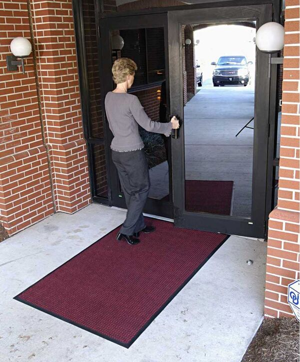 "waterhog classic 5 Floormat.com Perfect for most applications inside or out, Waterhog Classic's unique design makes it revolutionary. The raised rubber ""water dam"" border traps dirt and water, keeping them off carpet and floors. <ul> <li>24 oz.sq/yd solution-dyed polypropylene fabric is highly stain resistant</li> <li>SBR rubber backing contains 20% recycled rubber content</li> <li>3/8"" thick bi-level surface effectively removes and stores dirt and moisture beneath shoe level between cleanings</li> <li>Rubber reinforced face nubs prevent pile from crushing extending performance life of product</li> <li>Unique ""Water Dam"" allows the Waterhog mat to hold up to 1 1/2 gallons of water per square yard, water and dirt stay on the mat</li> <li>Anti-Static</li> <li>Recommended for commercial buildings, hotels, restaurants, healthcare facilities, office buildings and more</li> </ul>"